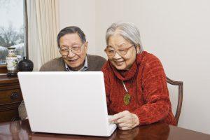iStock_000008311192Large couple on computer